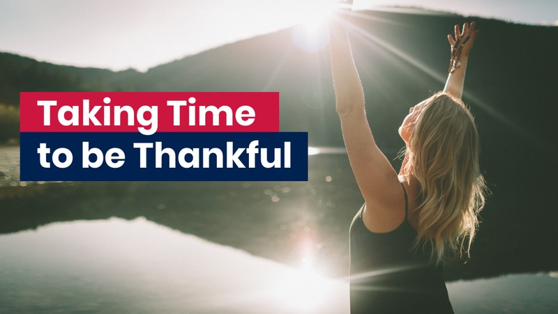 Woman with arms raised in the air being thankful