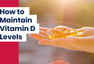 Hand holding pills to maintain Vitamin D levels